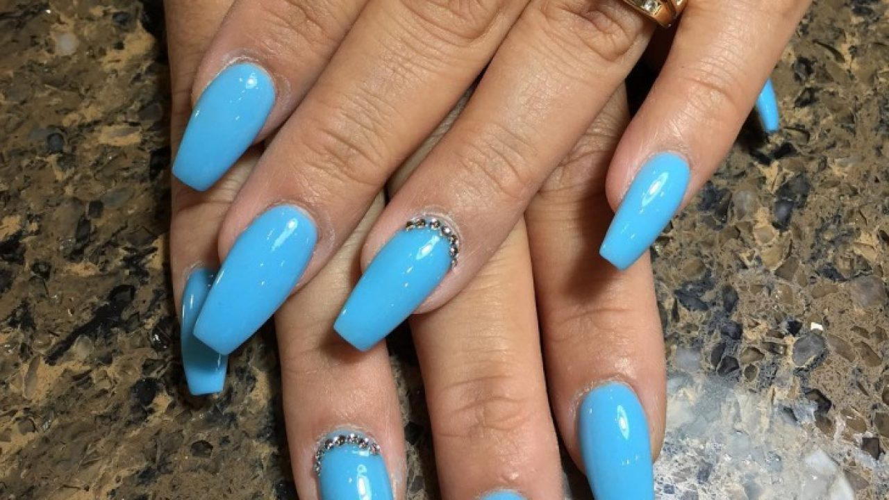 Blue coffin shaped nails with design , New Expression Nails