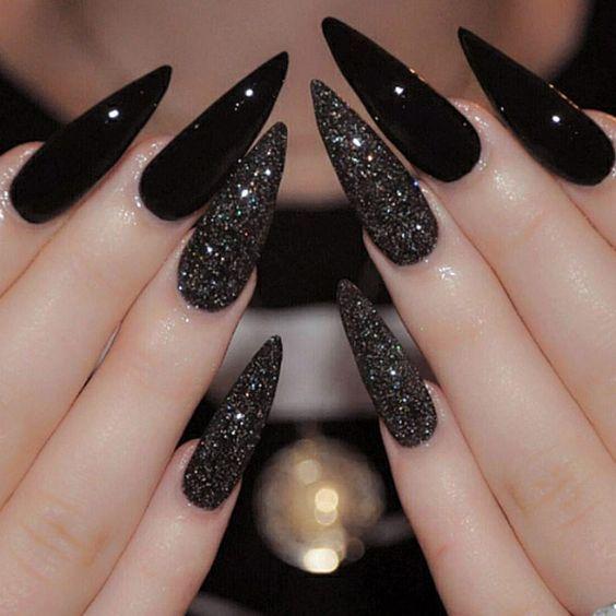 black acrylic nails glitter accent stiletto photo - 1