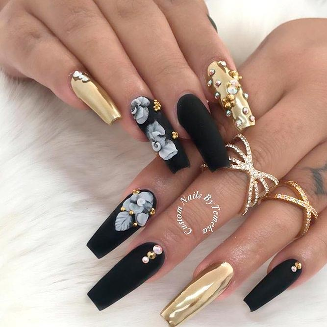 Black coffin shaped nails with white designs , New