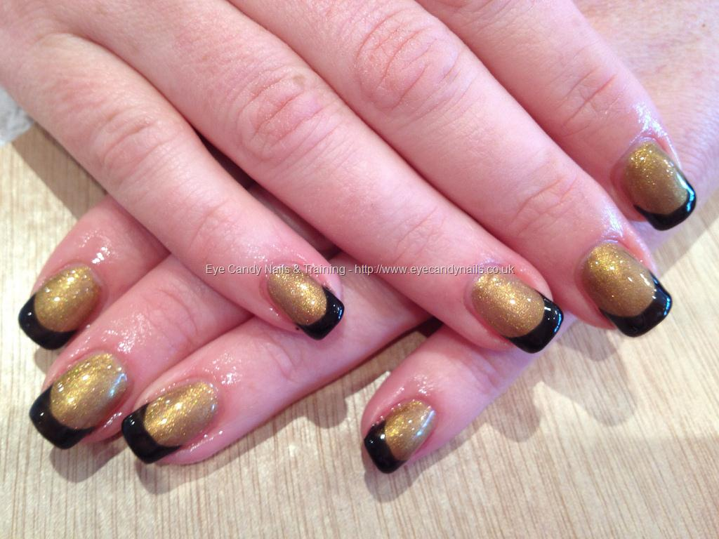 black gel nails with gold tips photo - 1