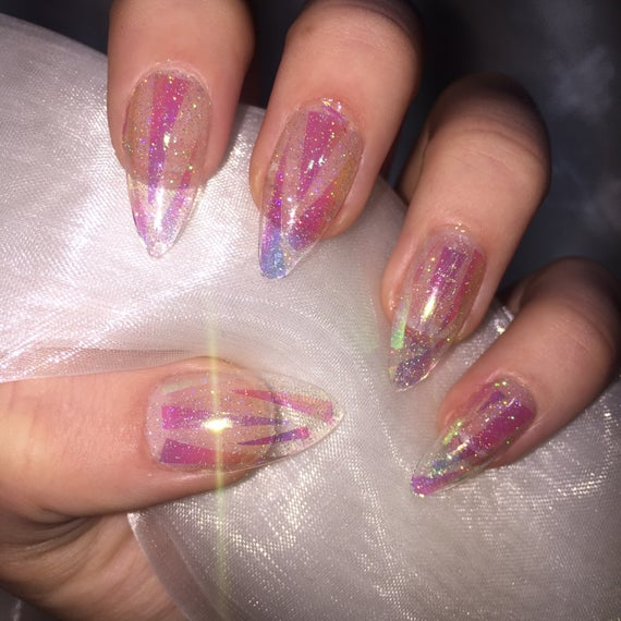 clear translucent luminescent opal stiletto nails photo - 1