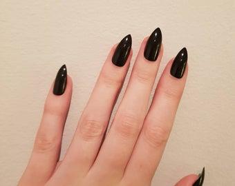 glue on black stiletto nails photo - 2