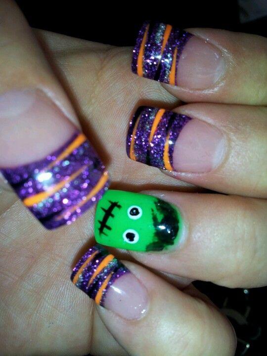 purple and orange halloween gel nails photo - 2
