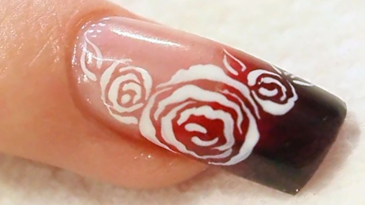 red acrylic nails with roses photo - 1