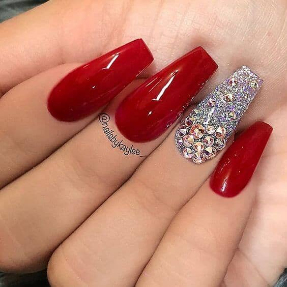 red coffin acrylic nails with rhinestones photo - 1