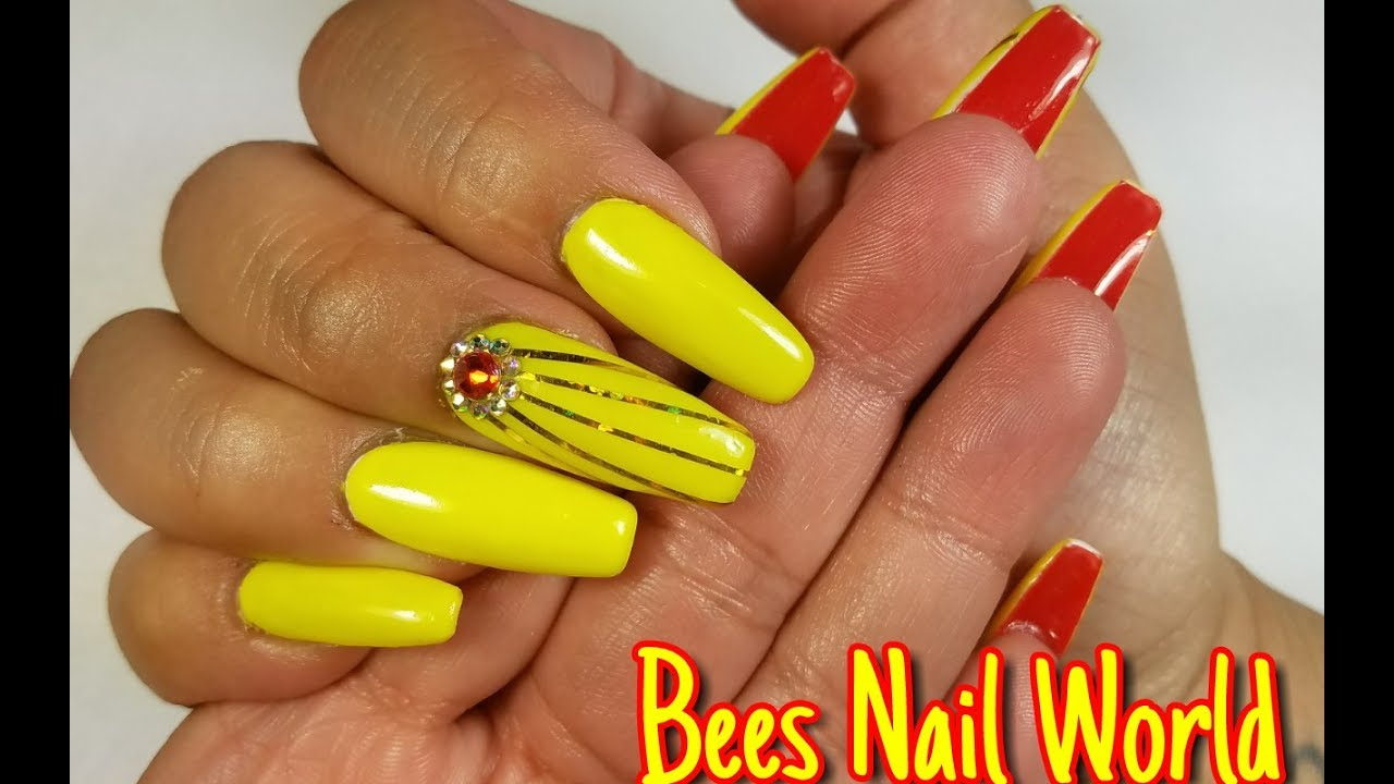 red yellow and red nails coffin photo - 1