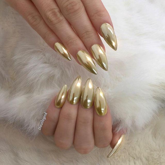 stiletto nails gold photo - 1