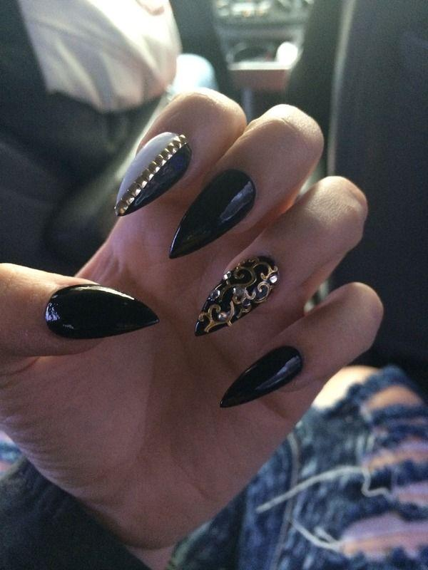 stiletto nails manicure black and gold photo - 1