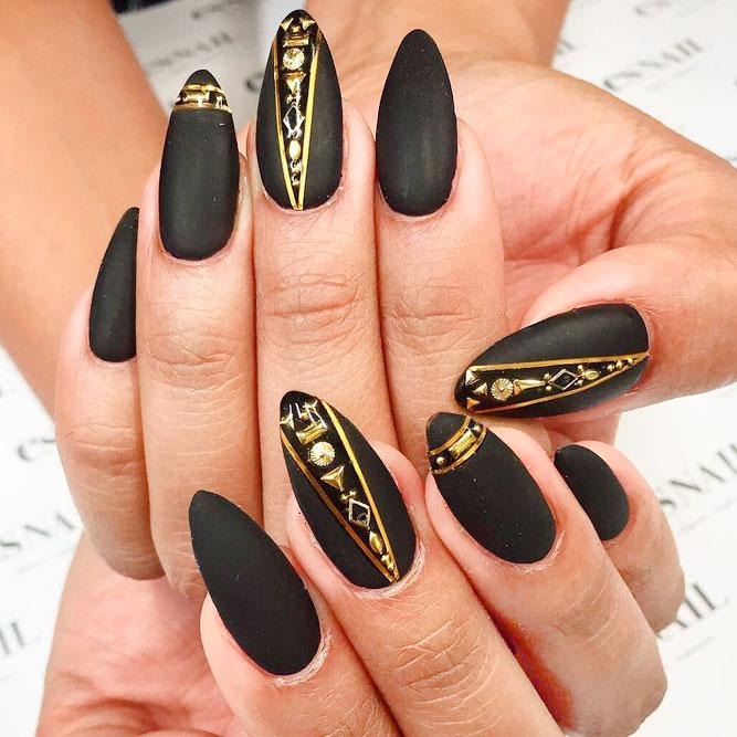 stiletto nails manicure black and gold photo - 2