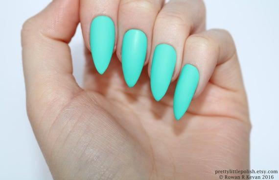 stiletto nails turquoise and black photo - 2