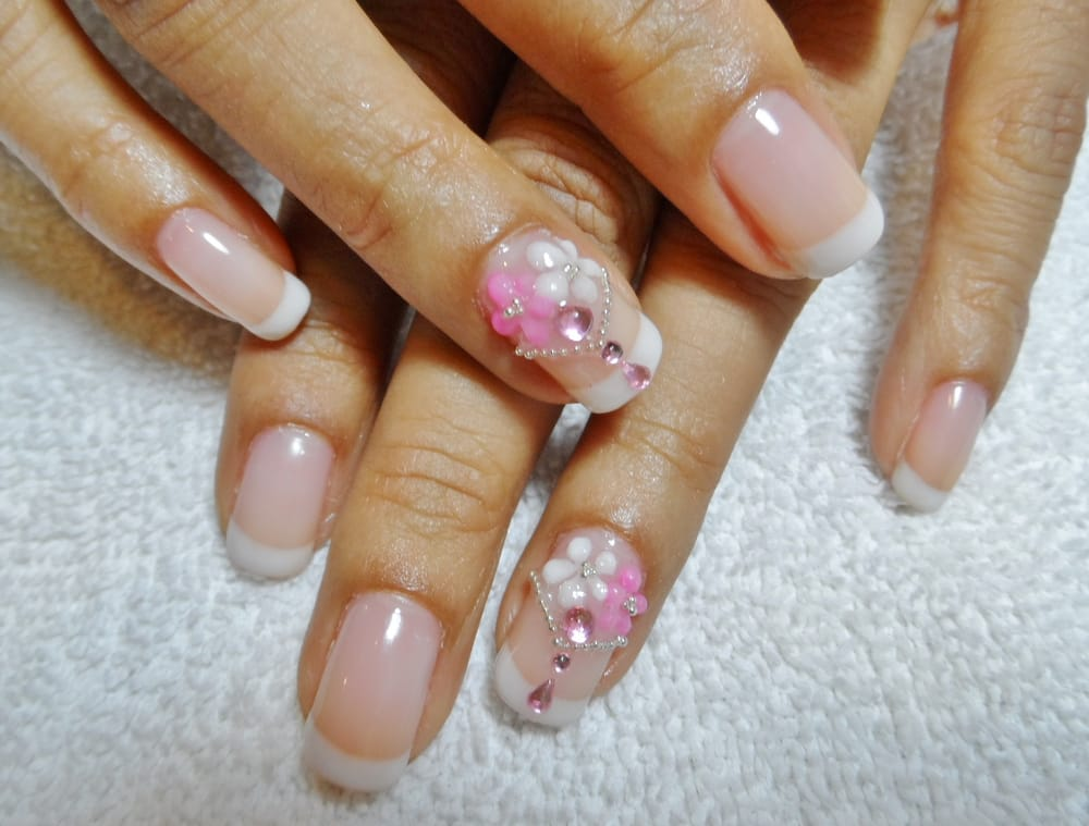 white gel nails with flower gems photo - 2