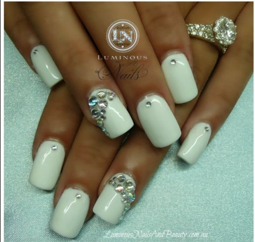 white gel nails with gold triangle nail gems photo - 1